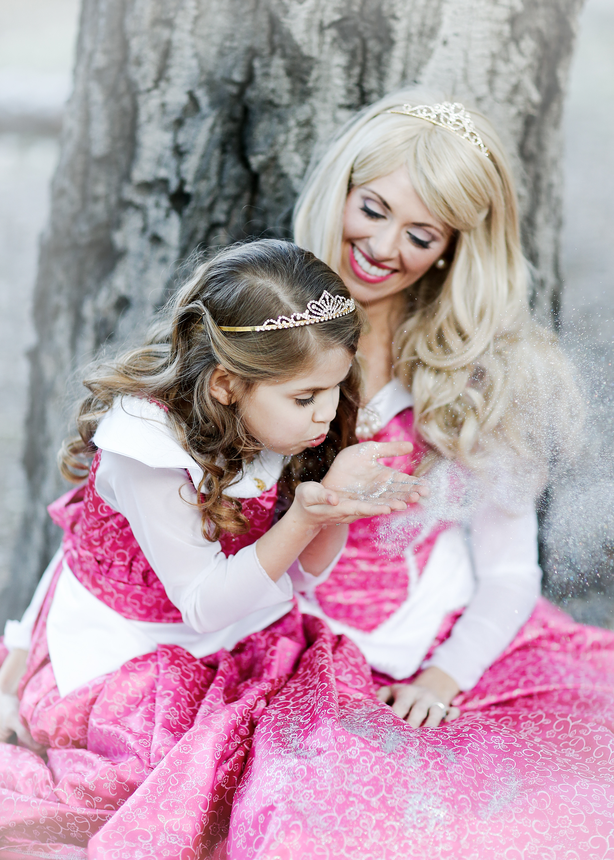 Mother-Daughter - Meagan is a beautiful soul and owner of an amazing company that gives her the opportunity to spread magic and love wherever she goes (in costume of course).She takes pictures with little ones celebrating birthdays all year long and she knew it was time to schedule a session with her own daughter. She wanted a special mother-daughter portrait series in matching princess dresses and we captured the magic of that moment in beautiful outdoor series.What is your vision? Let's make it happen!