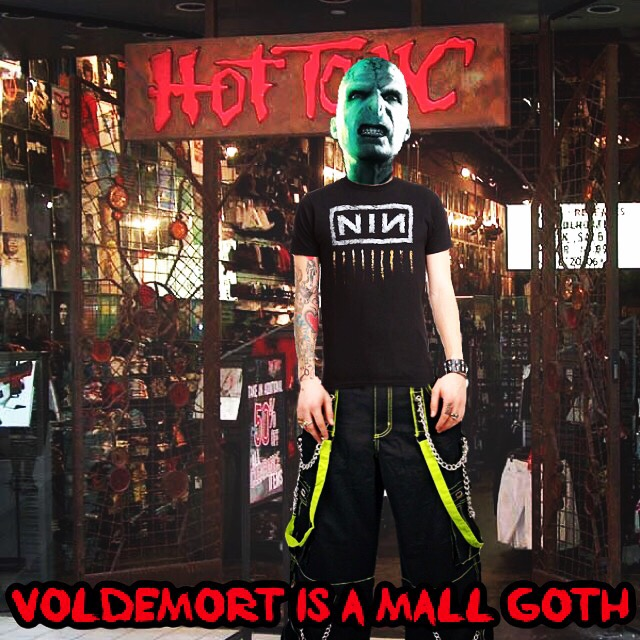"Voldemort stands in front of the entrance to a Hot Topic, wearing black parachute pants with neon green straps, a studded bracelet, and a nine inch nails shirt. He sneers into the camera. Text at the bottom reads, ""Voldemort is a mall goth."""