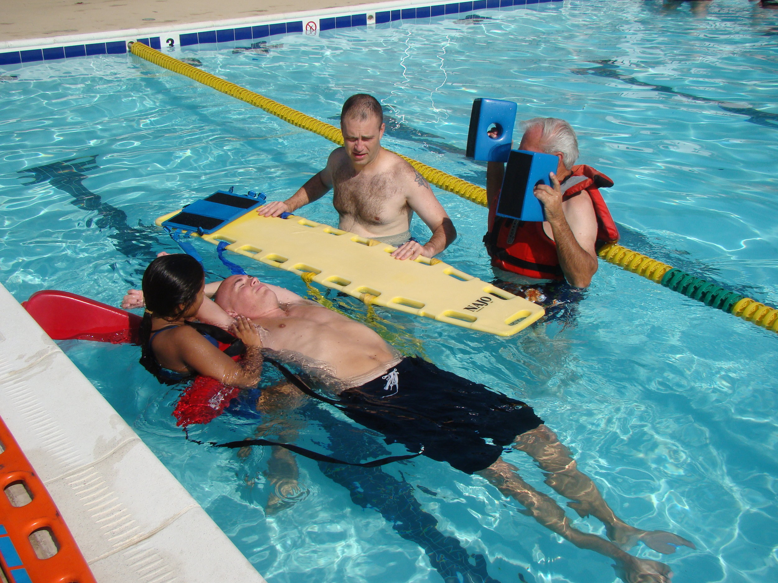 Lifeguards training during the season with the local fire department