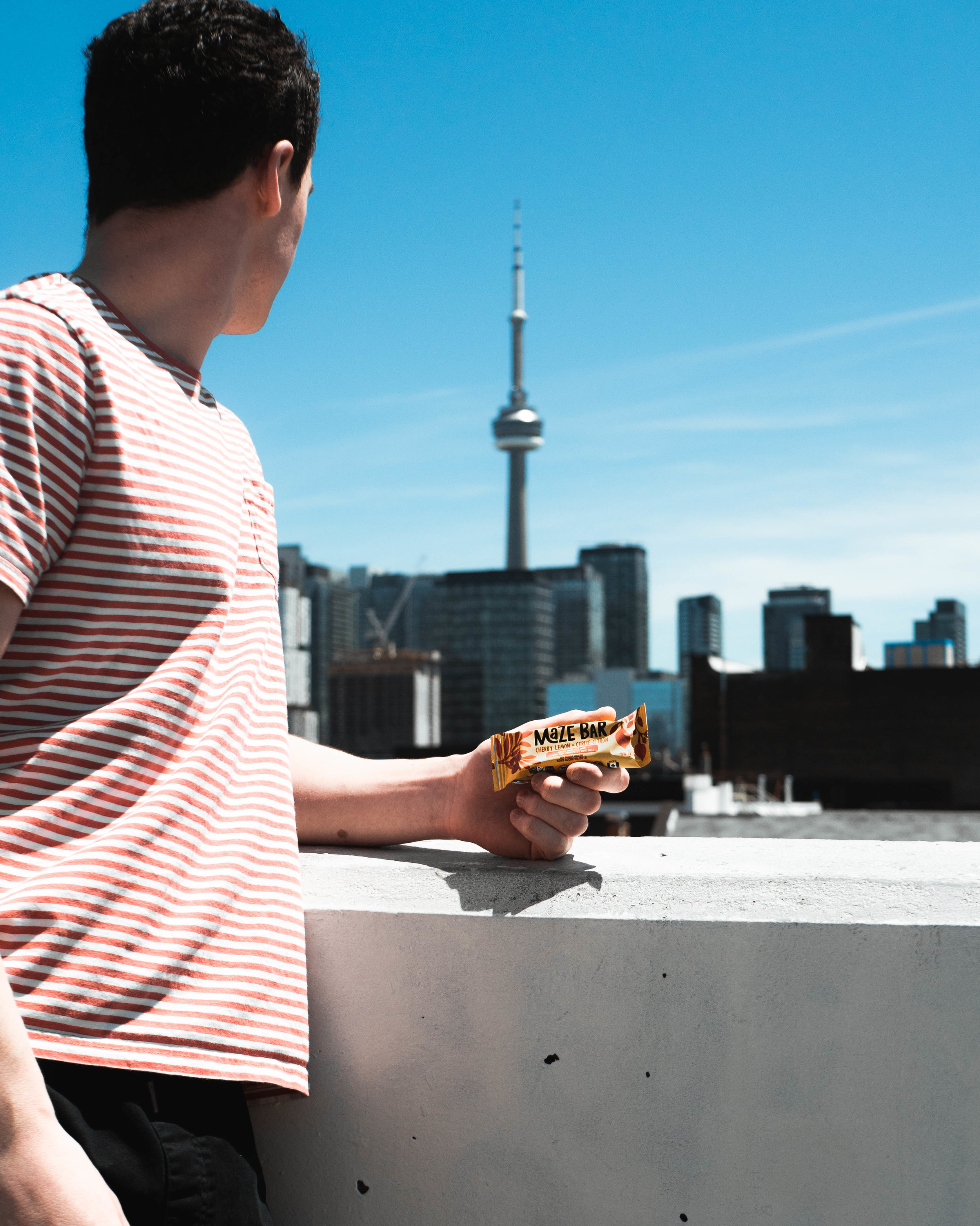 Maze Bar in hand looking out over Toronto.jpg