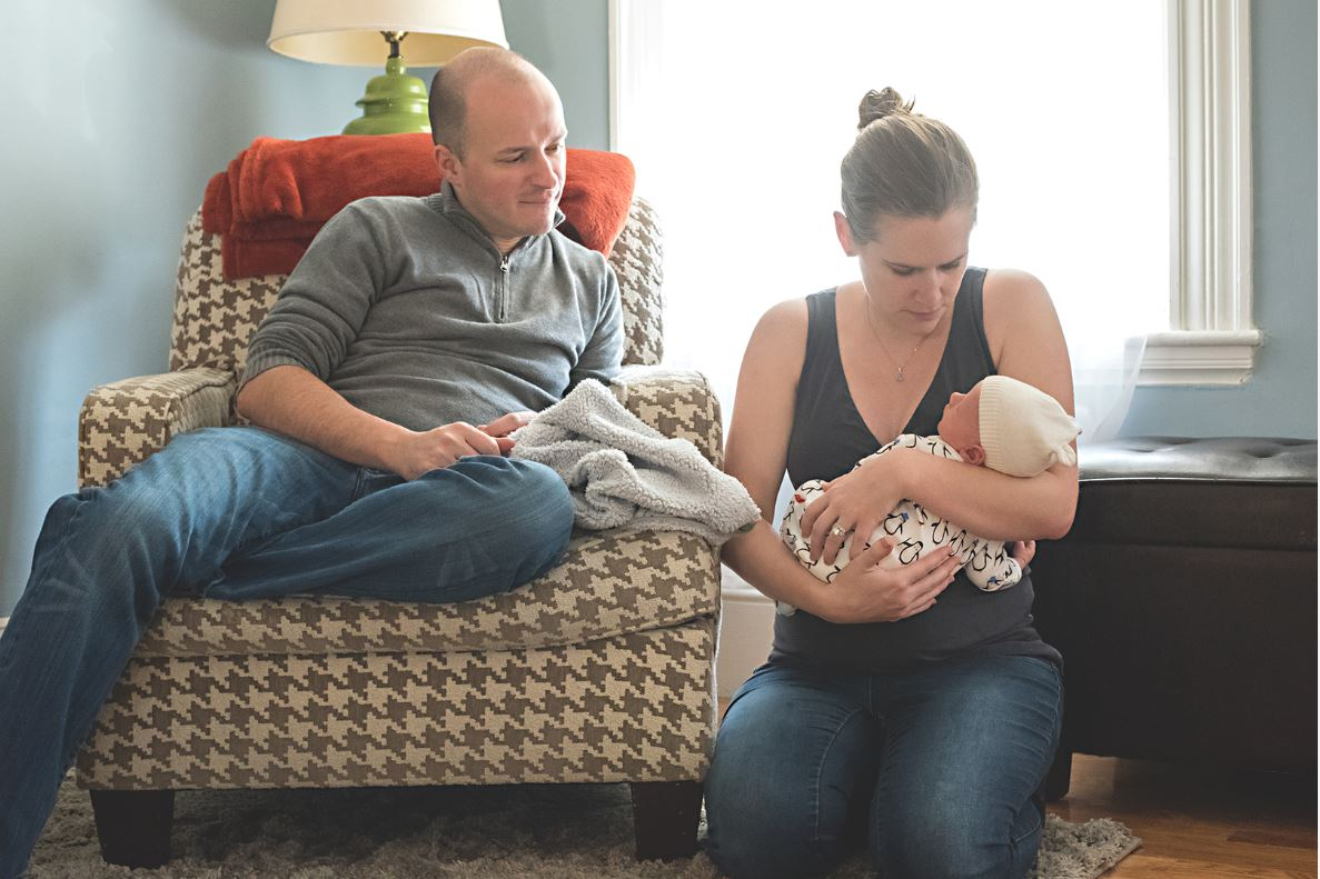 mom dad and baby lifestyle newborn photography candid
