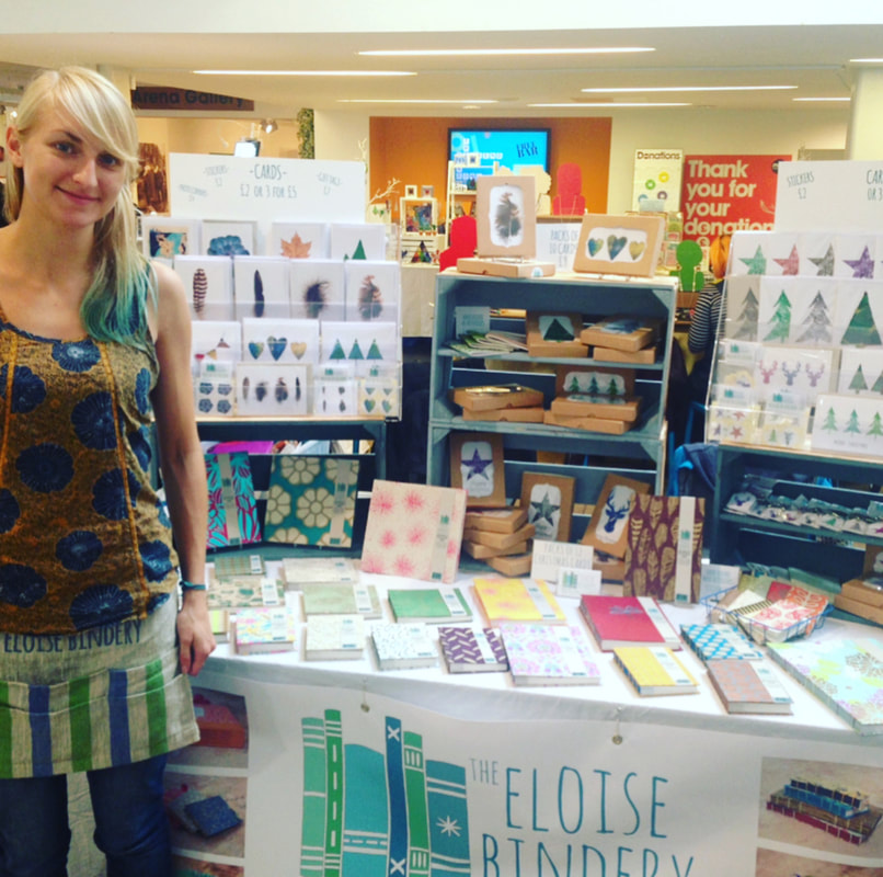 Eloise and her colourful display of hand-made books