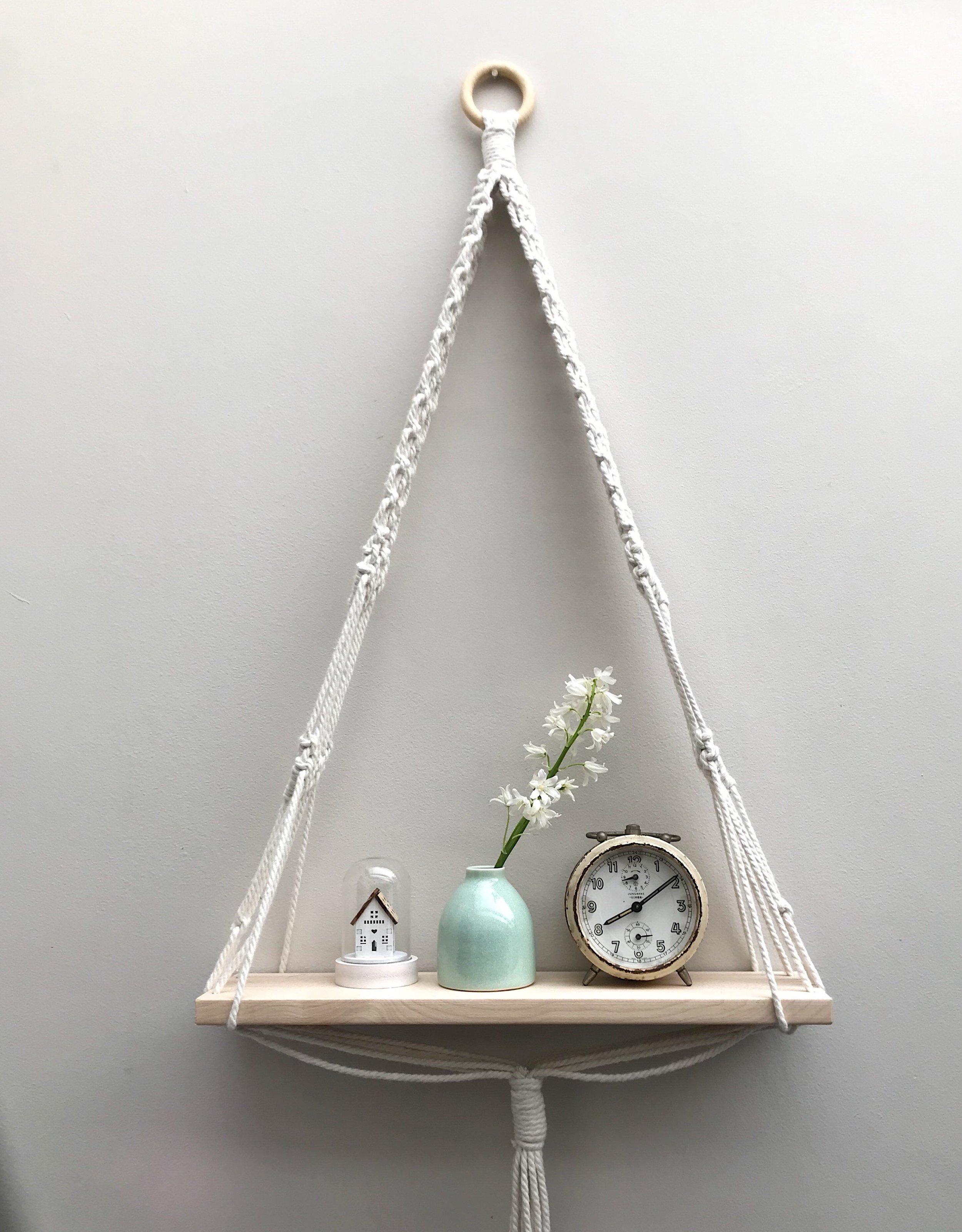 Macrame shelf by Isabella Strambio featuring mint green bud-vase by Kt Robbins Ceramics
