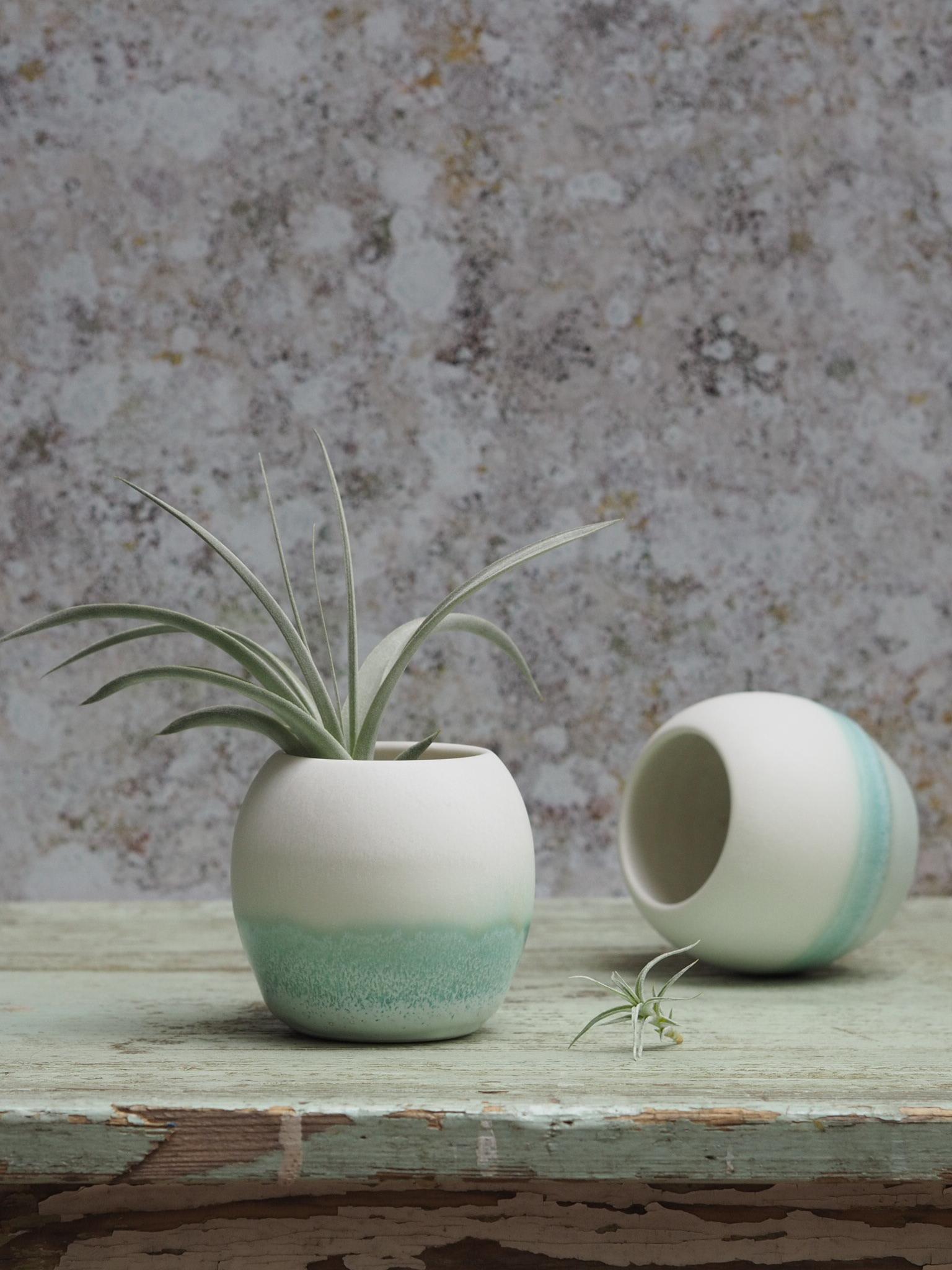 A close-up of the glaze detail on a Kt Robbins Ceramics sea-pearl porcelain plant pot