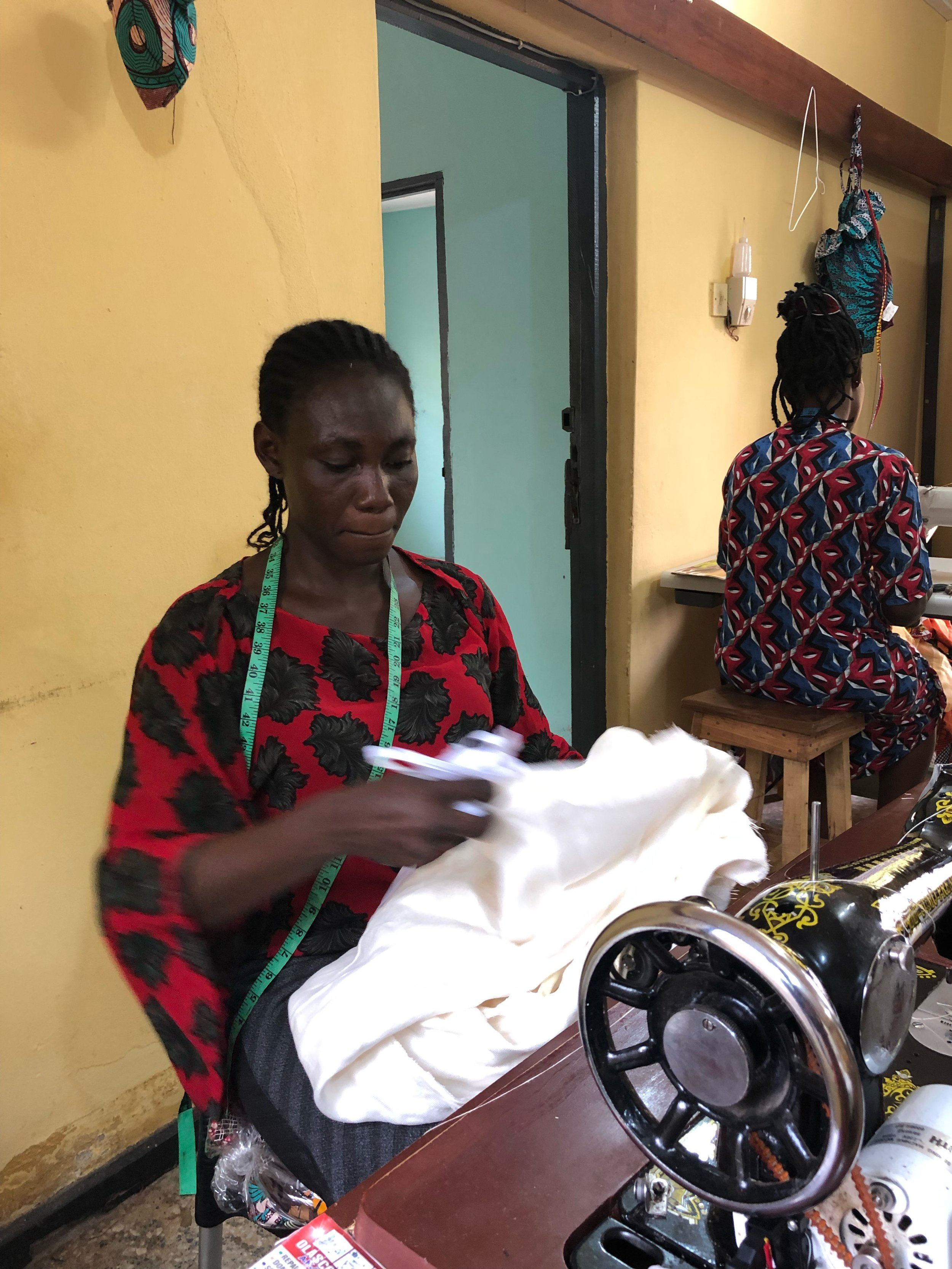 """- """"We pay our tailors fair living wages. Many aspiring tailors find it hard to make a living because they haven't attained a loyal customer base. Through our workshop, they can simply earn a fixed salary and continue growing their client base on the side.""""-Sophia Danner-Okotie"""