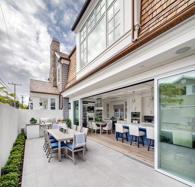 We've said it before and we'll say it again: we love dinner al fresco!  Bringing this beautiful home together was easy thanks to a great team: Architect: @brandonarchitects Interior Design: @sydney__wfdinteriors Photo: @chadmellon      #thenewstandard #coronadelmar