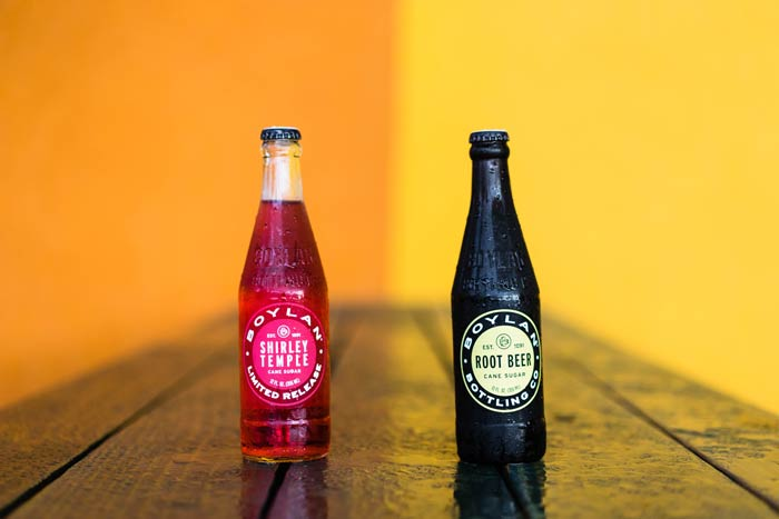 product-photography-of-two-glass-soda-bottles-on-restaurant-tabletop-in-jacksonville-florida.jpg
