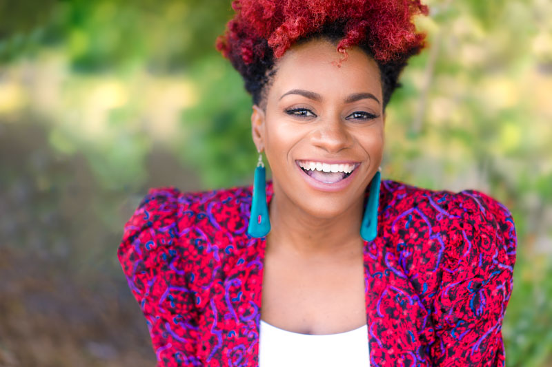 authentic-professional-headshot-outdoors-of-laughing-black-woman-.jpg