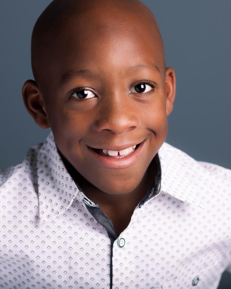 professional-child-actor-headshot-of-african-american-boy-in-jacksonville-florida-studio.jpg