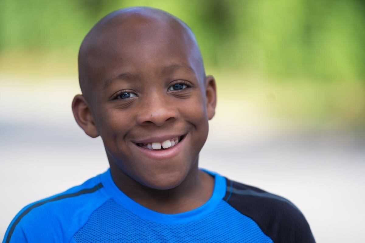 Actor headshot of young athletic African-American boy outdoors in Jacksonville, Florida