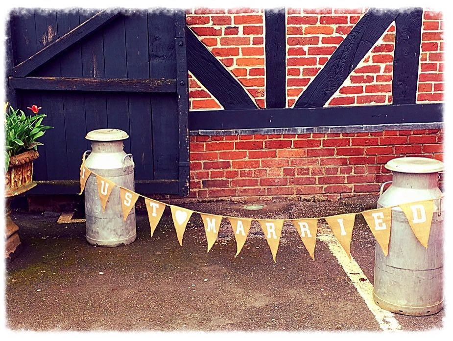 Milk churns and bunting.jpg