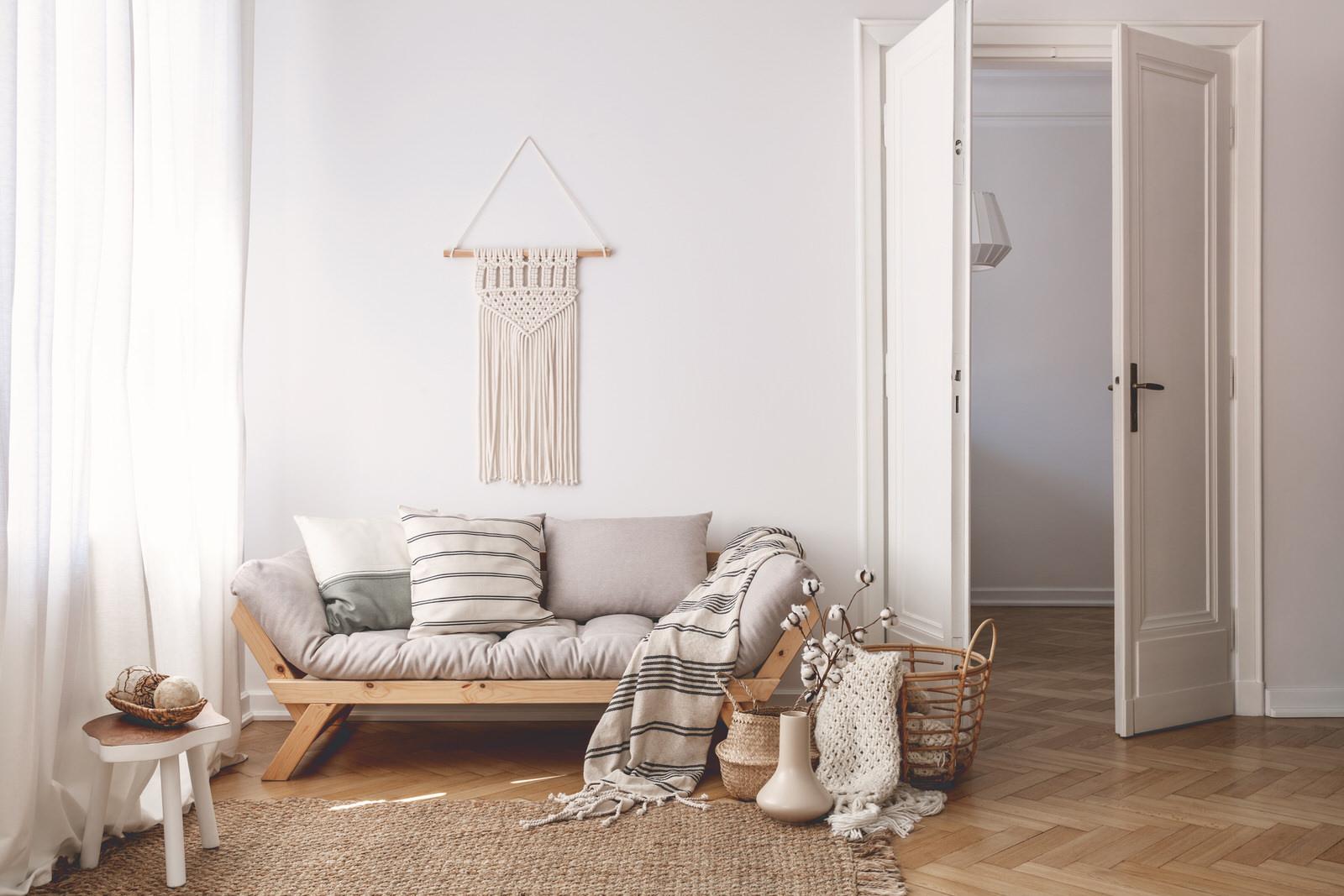 sunlit-living-room-interior-with-open-door-42UGF8Z.jpg