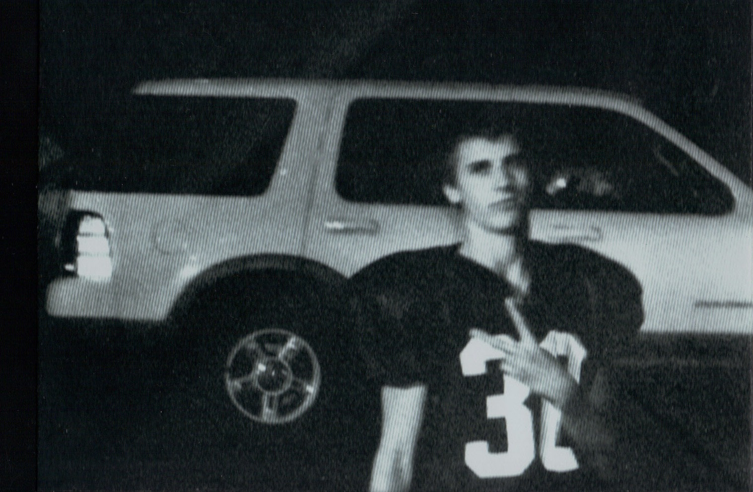 connor football uniform with car.jpg