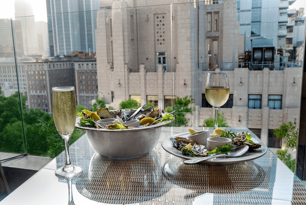 Perch Oysters with Champagne on Outdoor Patio Table.png