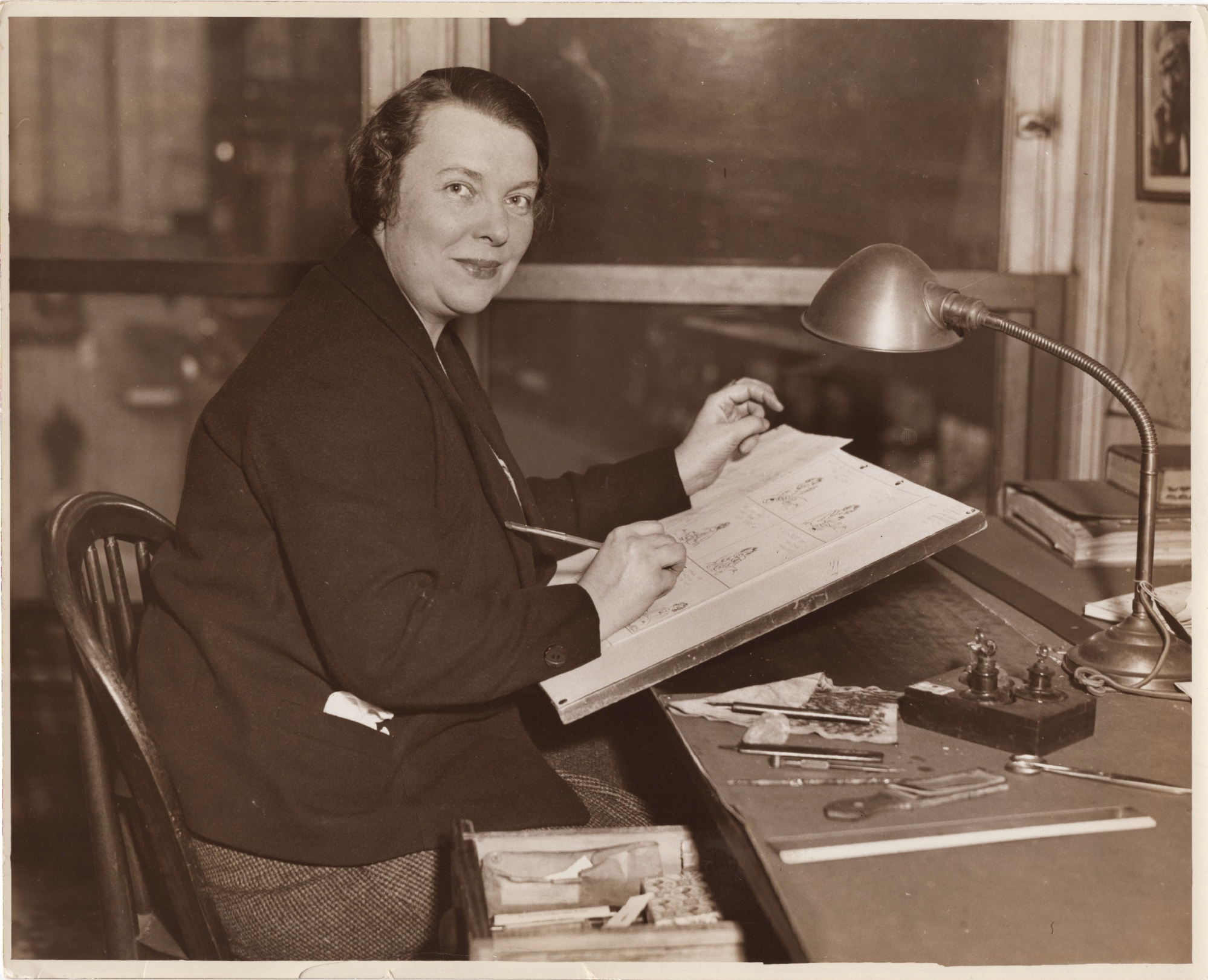 Edith Stevens at her Boston Post drawing table. Circa 1930's