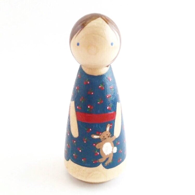 It all started when - Maria stumbled upon painted wooden peg dolls and began creating them for her kids. She began painting them for nieces and nephews and god-children... and just couldn't stop sharing the joy of a simple wooden peg with those she loved. In 2016, Maria opened her shop doors.She named the shop Punch & Judy Pegs in honor of the joyful, buoyant philosophy of one of her favorite authors, G.K. Chesterton. Chesterton believed that Fairy Tales are true, that Play is serious business, and that being alive is the grandest of adventures. In his autobiography, Chesterton wrote at length on the importance of play, of toys, of imagination, and of childhood on his development. He makes it clear that you will not understand him or his philosophy if you don't understand that all of his travels and successes