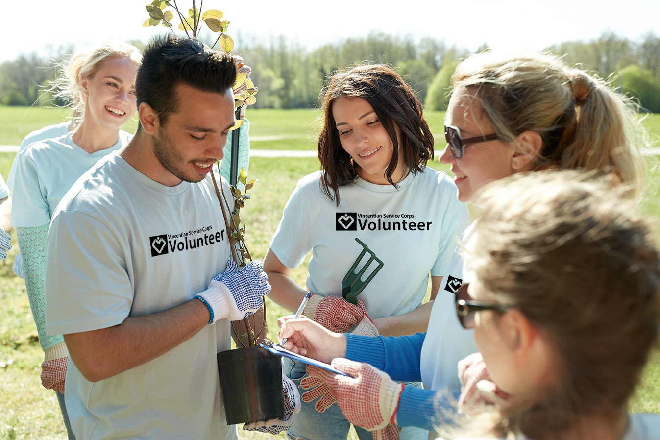 !group-of-volunteers-with-tree-seedlings-in-park-P7SJ7GF.jpg