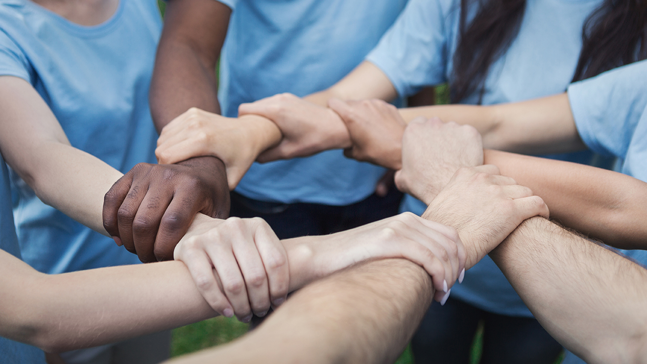 hands-of-young-people-joined-in-circle-AHUPBXC.jpg