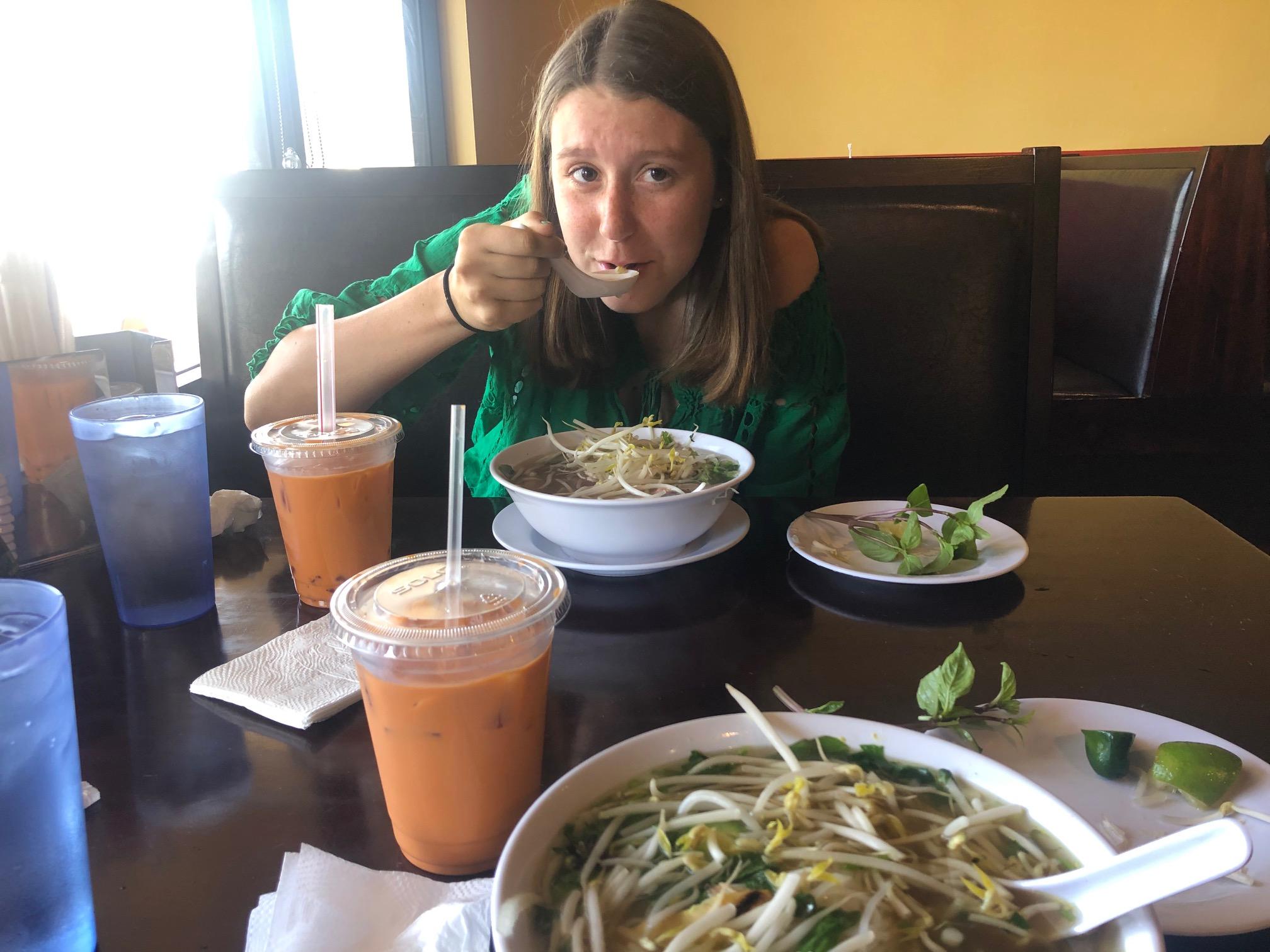 Charli eating pho.jpg