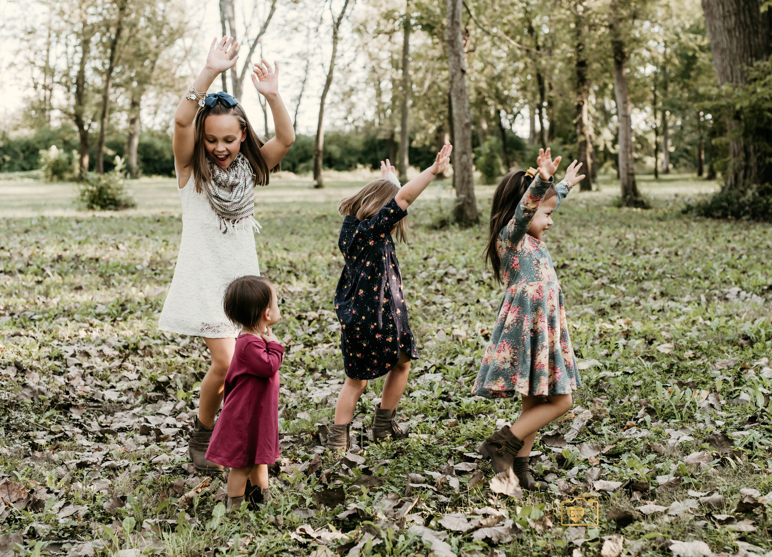 """""""Catching a sweet moment here of these four cousins playing and twirling around together not paying attention to the camera."""""""