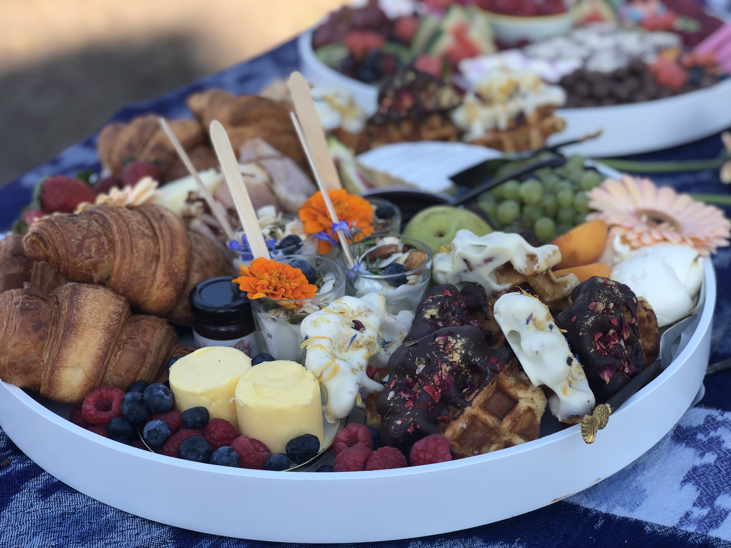 + HOW DO YOU BRUNCH?+ - Croissants, homemade chocolate dipped waffles, danish, yoghurt pots, jams, butter, brie, Jarlsberg cheese, triple smoked ham, fresh fruit & the graze*55cm boardFeeds approximately 10 adults$180.00