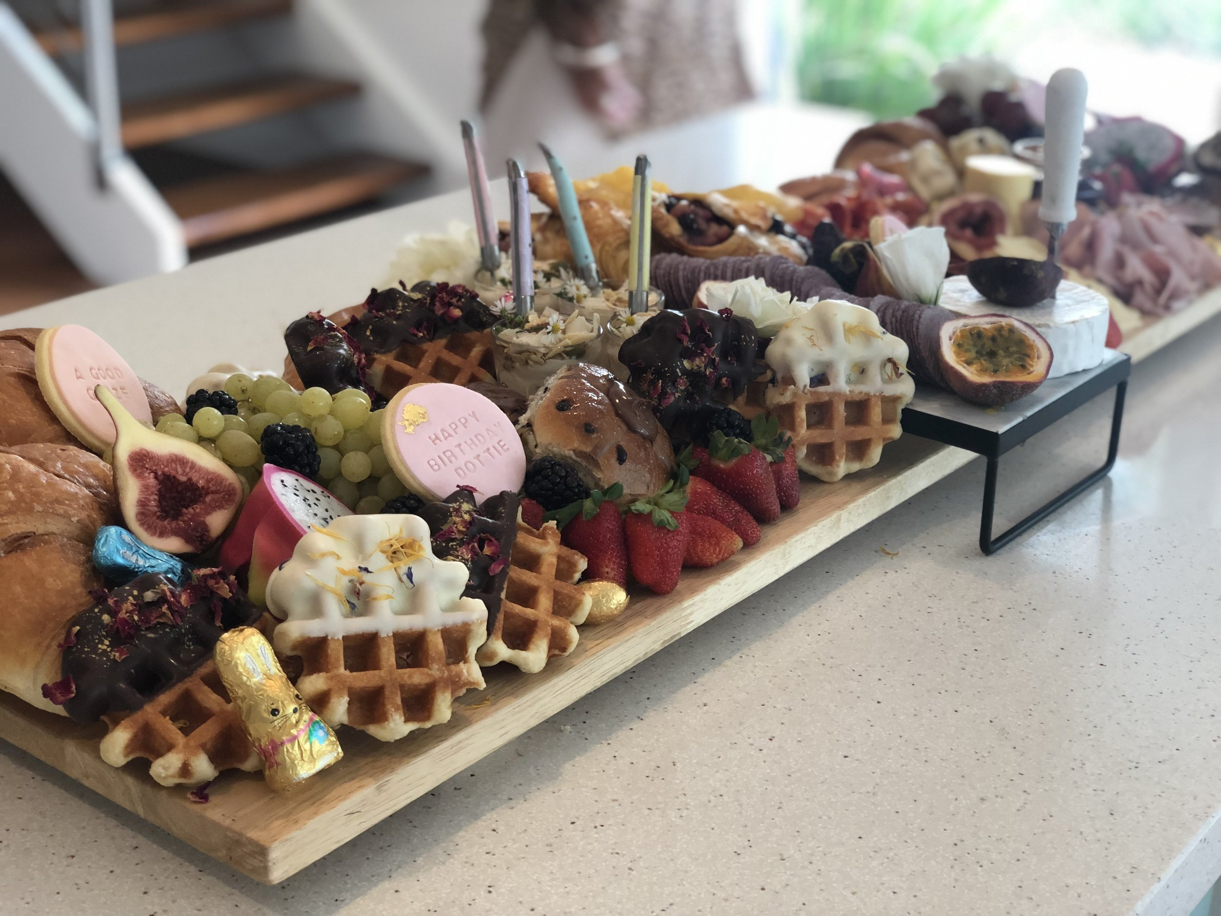 + Brunch for Days + - Croissants, homemade chocolate dipped waffles, danish, yoghurt pots, jams, butter, brie, Jarlsberg cheese, triple smoked ham, fresh fruit & the graze*1.2m X 30cmFeeds approximately 20-25 adults$380