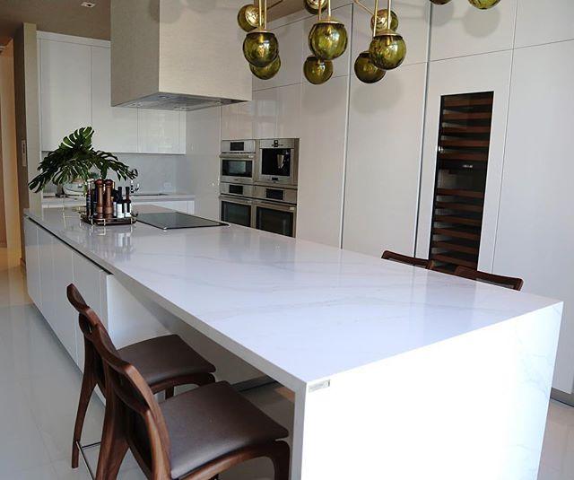 This modern, sleek design using Silestone Calacatta Gold will capture your heart.