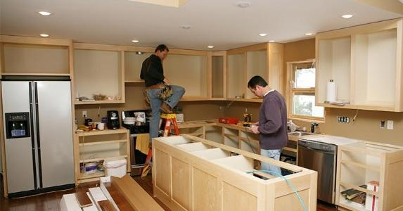 men-remodeling-kitchen-working-on-cabinets-getty_573x300.jpg
