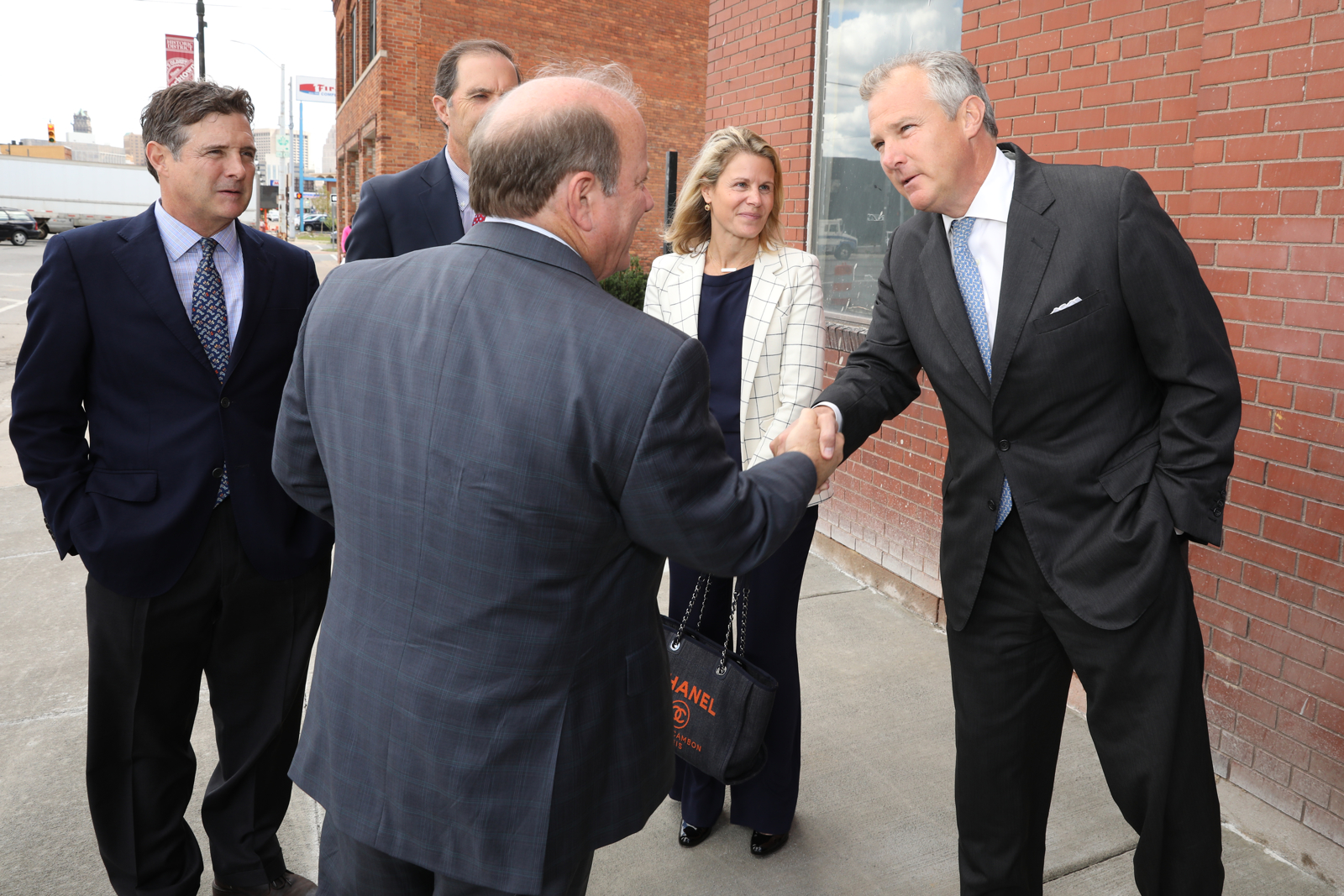 Tom shaking hands with Mayor Mike Duggan at the ribbon cutting of The Factory at Corktown in September, 2017. Also pictured with Tom (left to right) is brother Robbie, partner Britt Greene, and wife Lindsey.