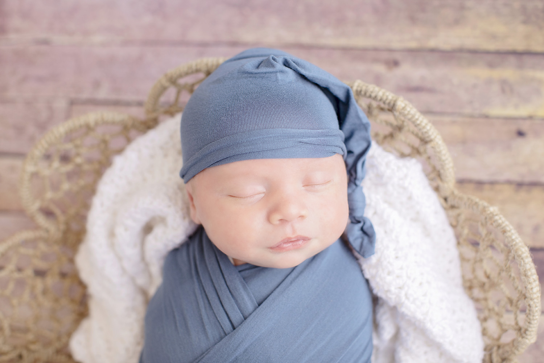 newborn-boy-swaddle-blue-cap.jpg