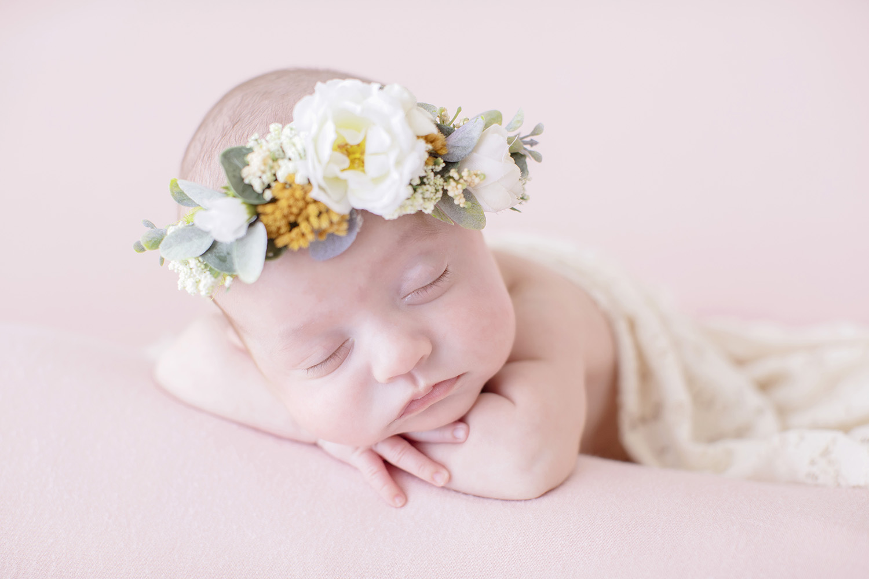 newborn-flower-crown-laying.jpg
