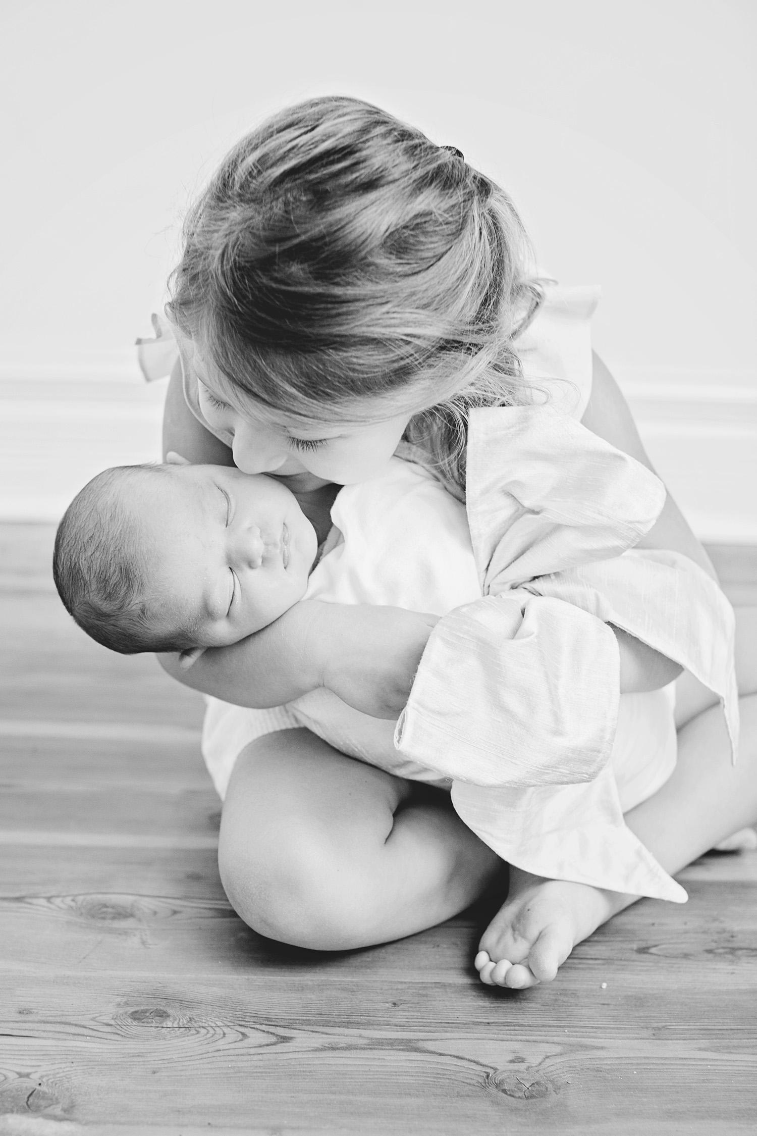 newborn-sister-kiss.jpg