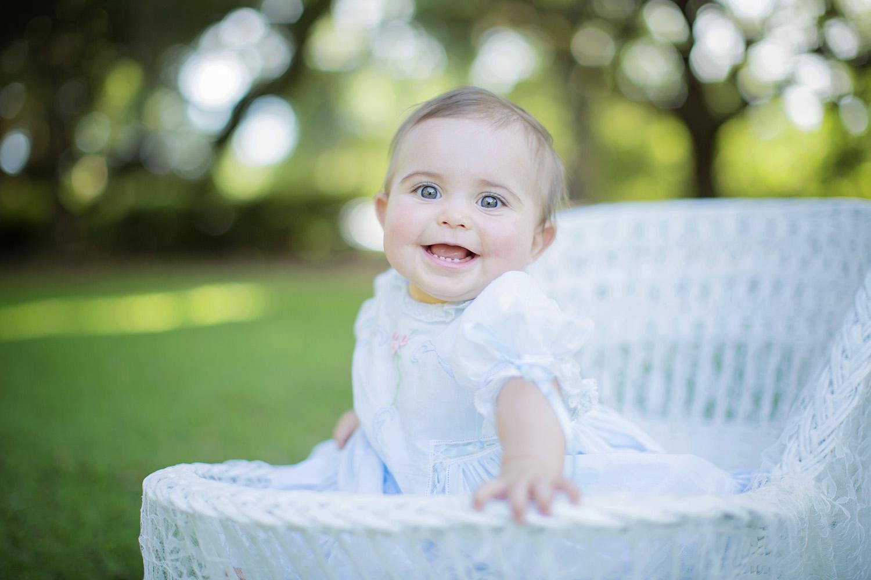baby-girl-sitting-wicker.jpg