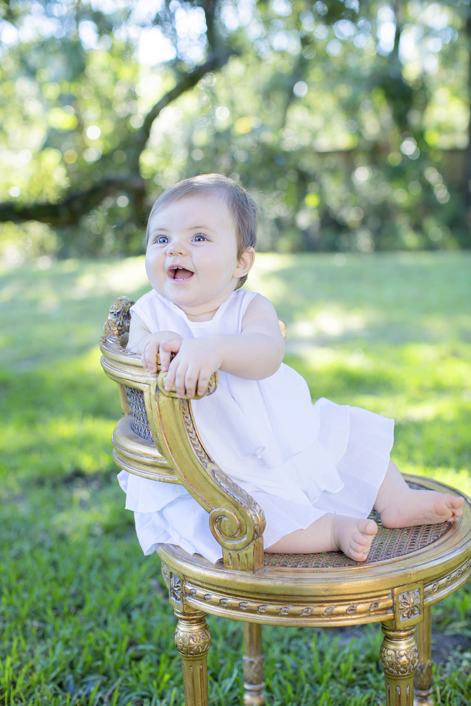 baby-girl-smiling-sitting.jpg