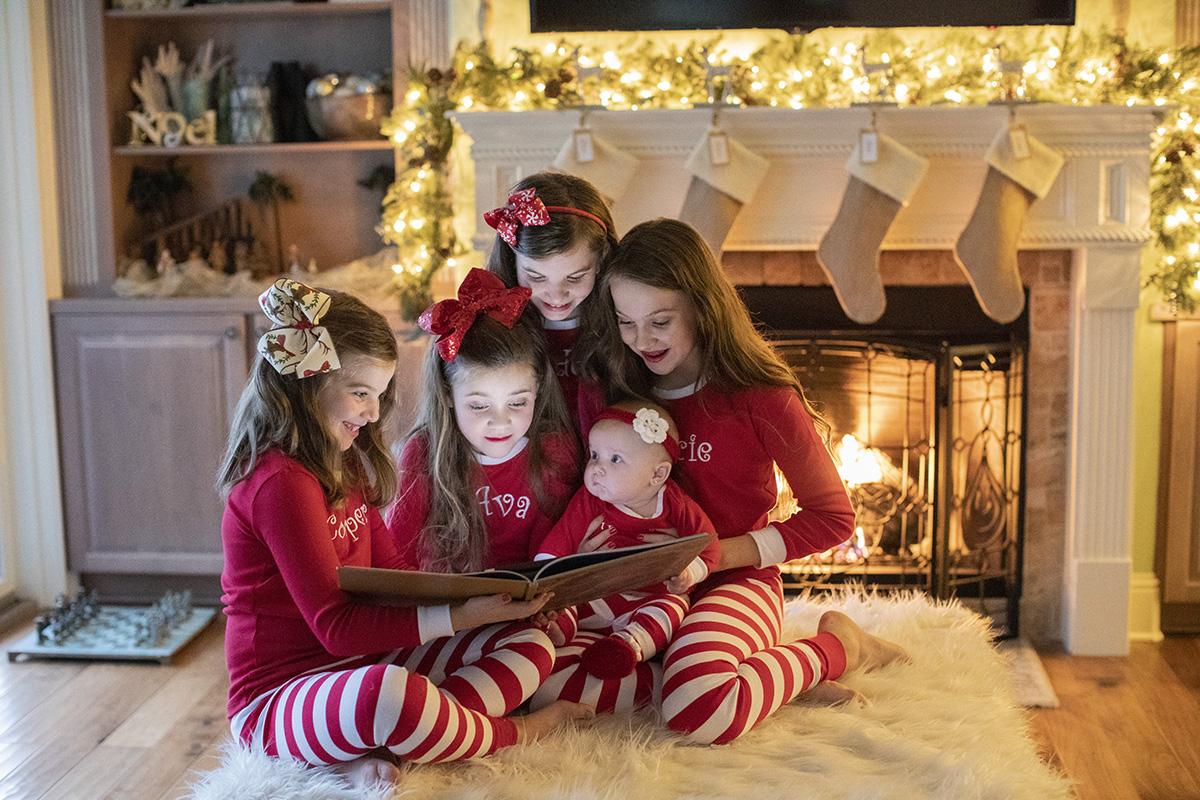 ocean-springs-newborn-photographer-fireplace-pajamas-sisters.jpg