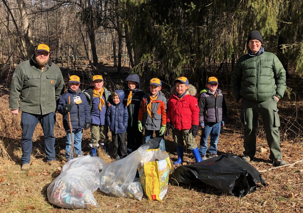 Cub Scout Den 3/Pack 118 show off the trash they recovered from the Dan Beard Trail.