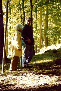 Lotte Fields walks with Gustav Olsen on her property in Redding. Mrs. Fields died in 2013 but left 21 acres of her land to the Redding Land Trust to keep as open space.