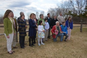 The Connelly family standing in the field they have protected with a Conservation Easement. Photo by Jane Hamilton-Merritt