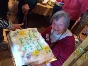 Mary Anne Guitar blows out the candles on the Redding Land Trust's 50th Anniversary Cake.