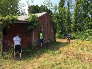 Cooper LeBlanc and Troop 15 Boy Scouts help restore the Barracker Barn