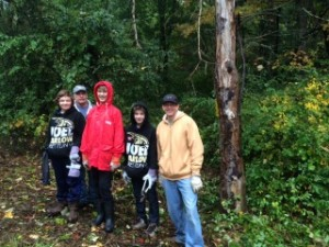 Scouts from Troop 15 clear invasive plants from the Dan Beard property