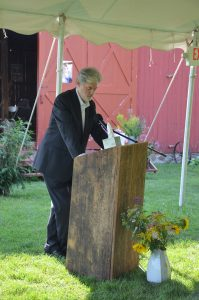 Nick Zittell speaks at the memorial for Mary Anne Guitar. -Photo by Jane Merritt