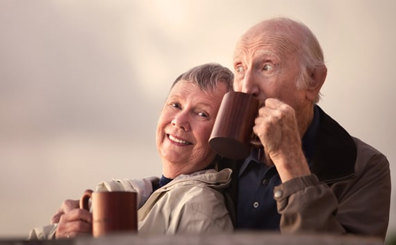 3bc69-elderly-couple-outside-drinking-coffee.jpg
