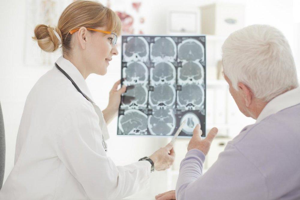 3953a-older-adult-looking-at-brain-scans.jpg