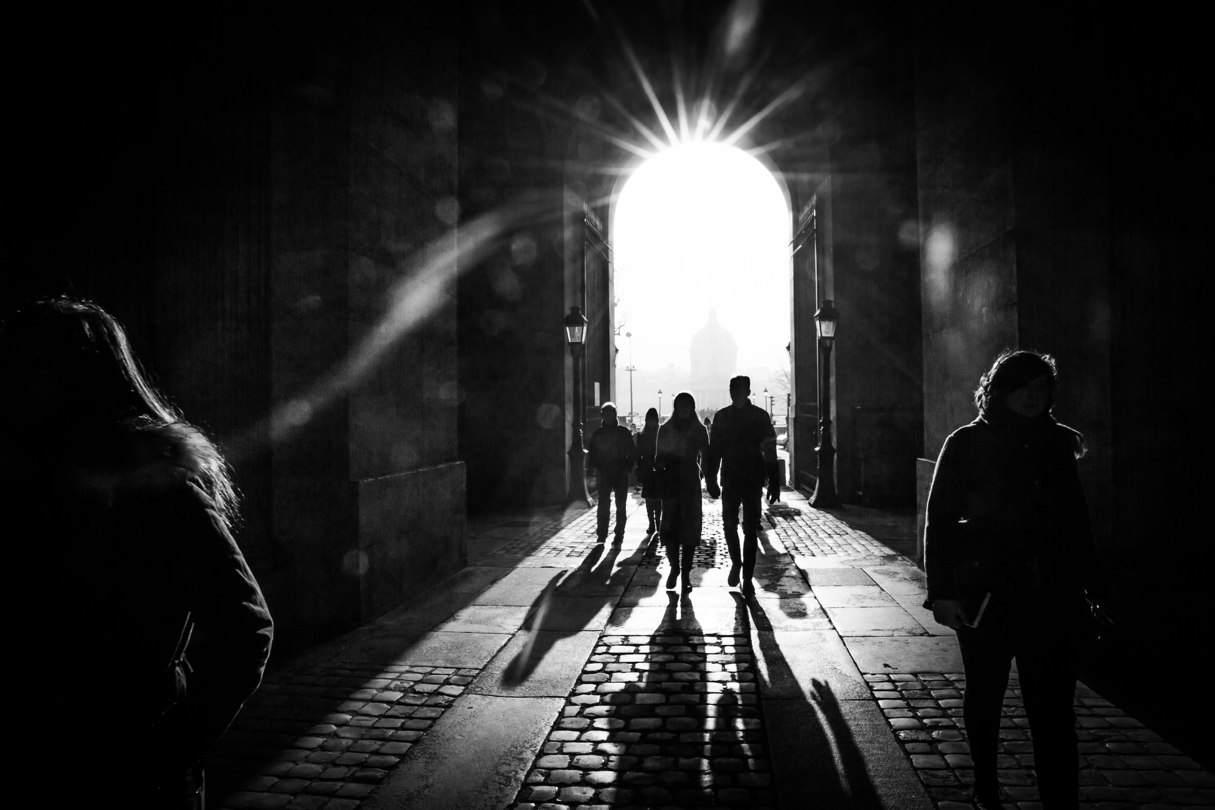 Paris-Louvre-People-Entering-Shadows-from-Beautiful-Light.jpg