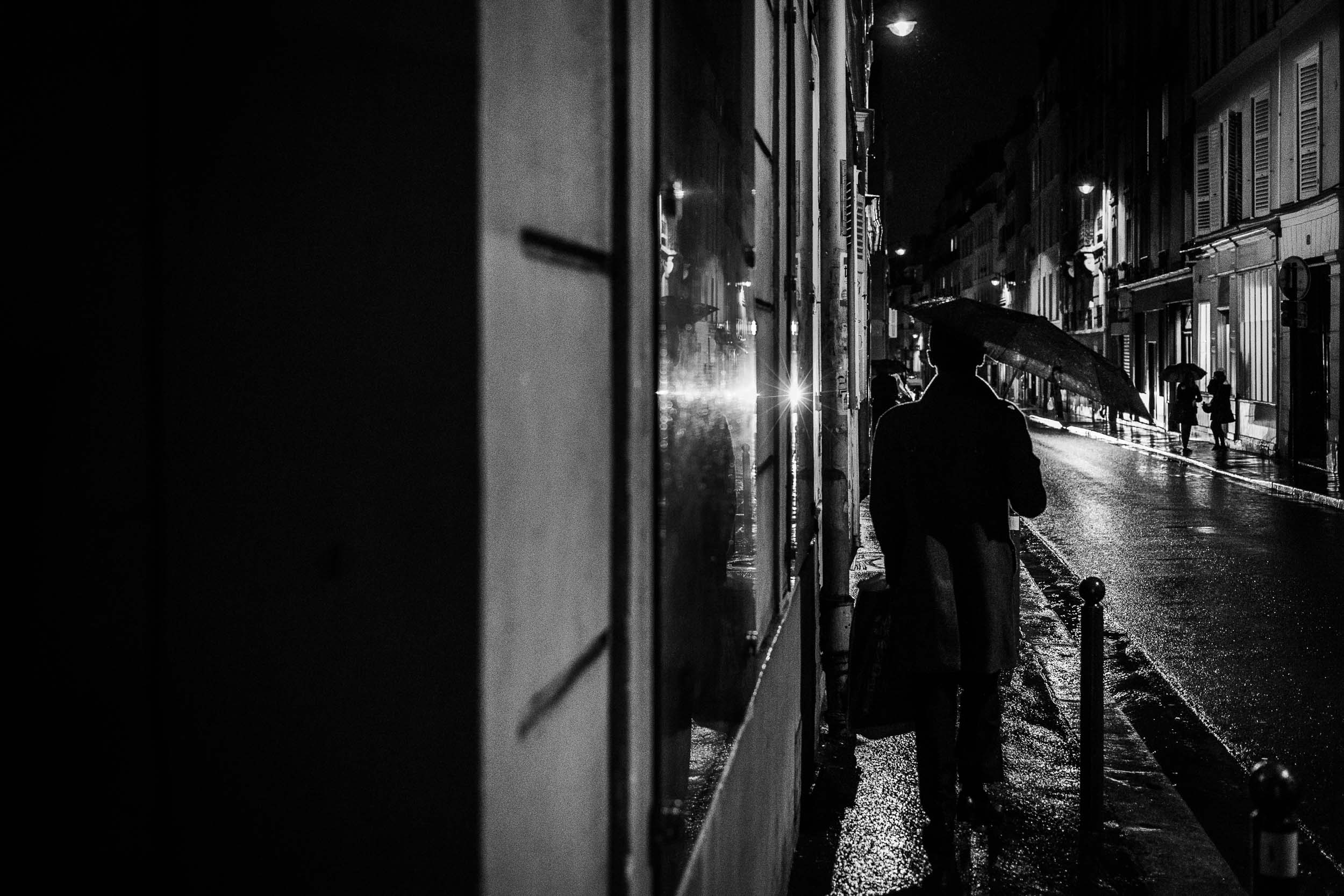 Paris-man-walking-with-umbrella-night.jpg