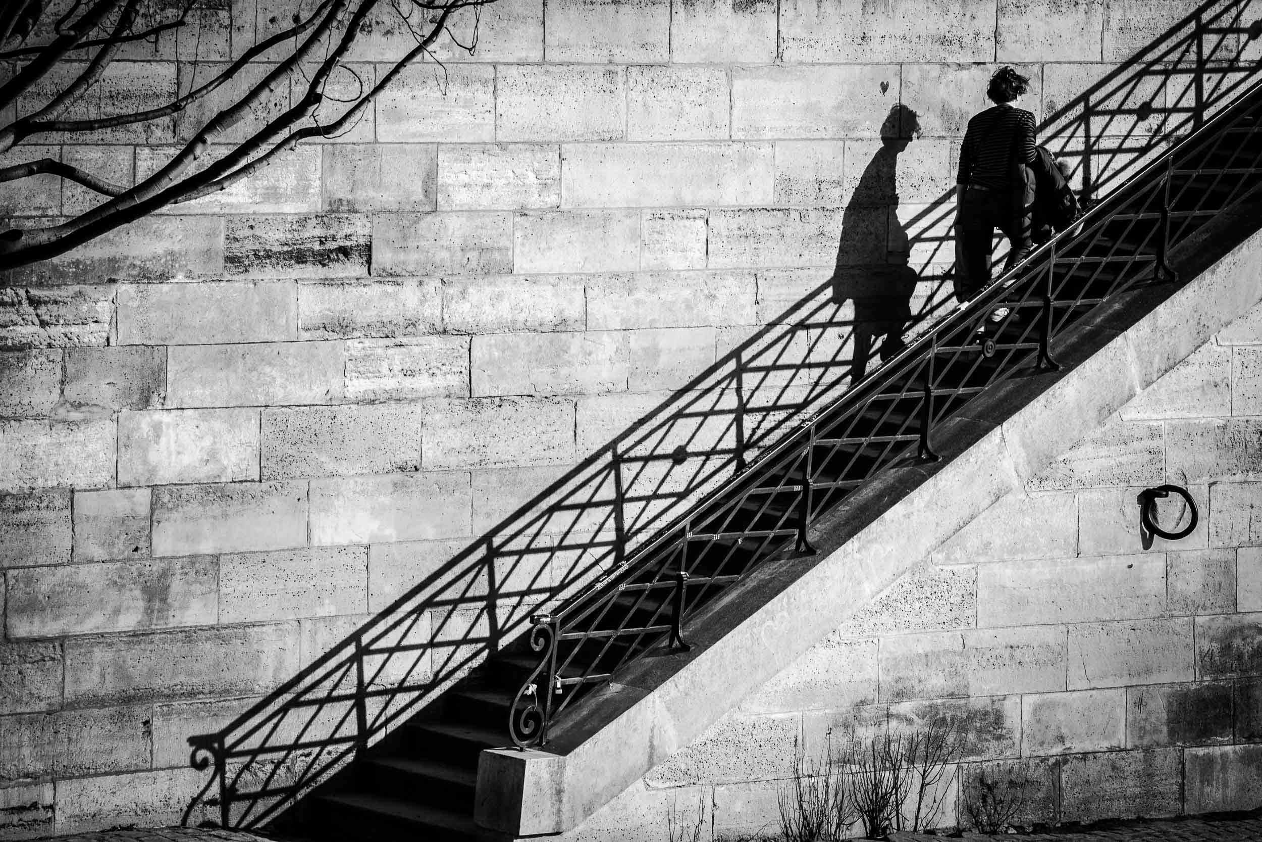 Paris-Quais-de-Seine-shadow-woman-walking.jpg