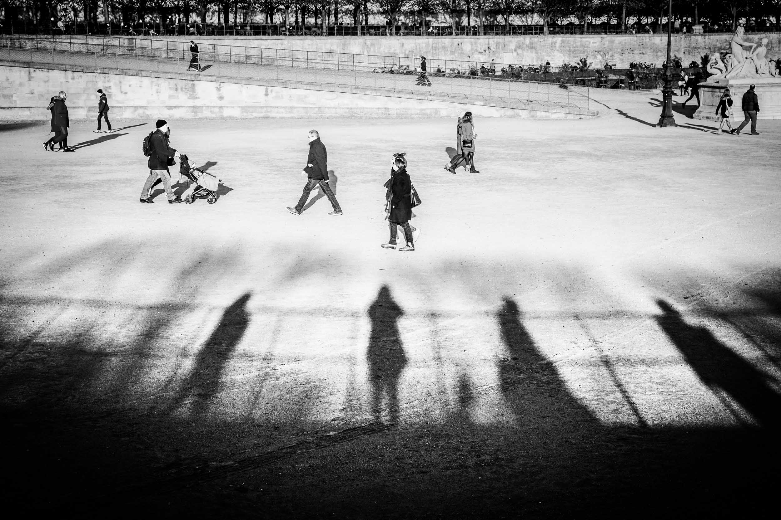 Paris-Tuileries-people-walking-shadows-of-people-watching.jpg