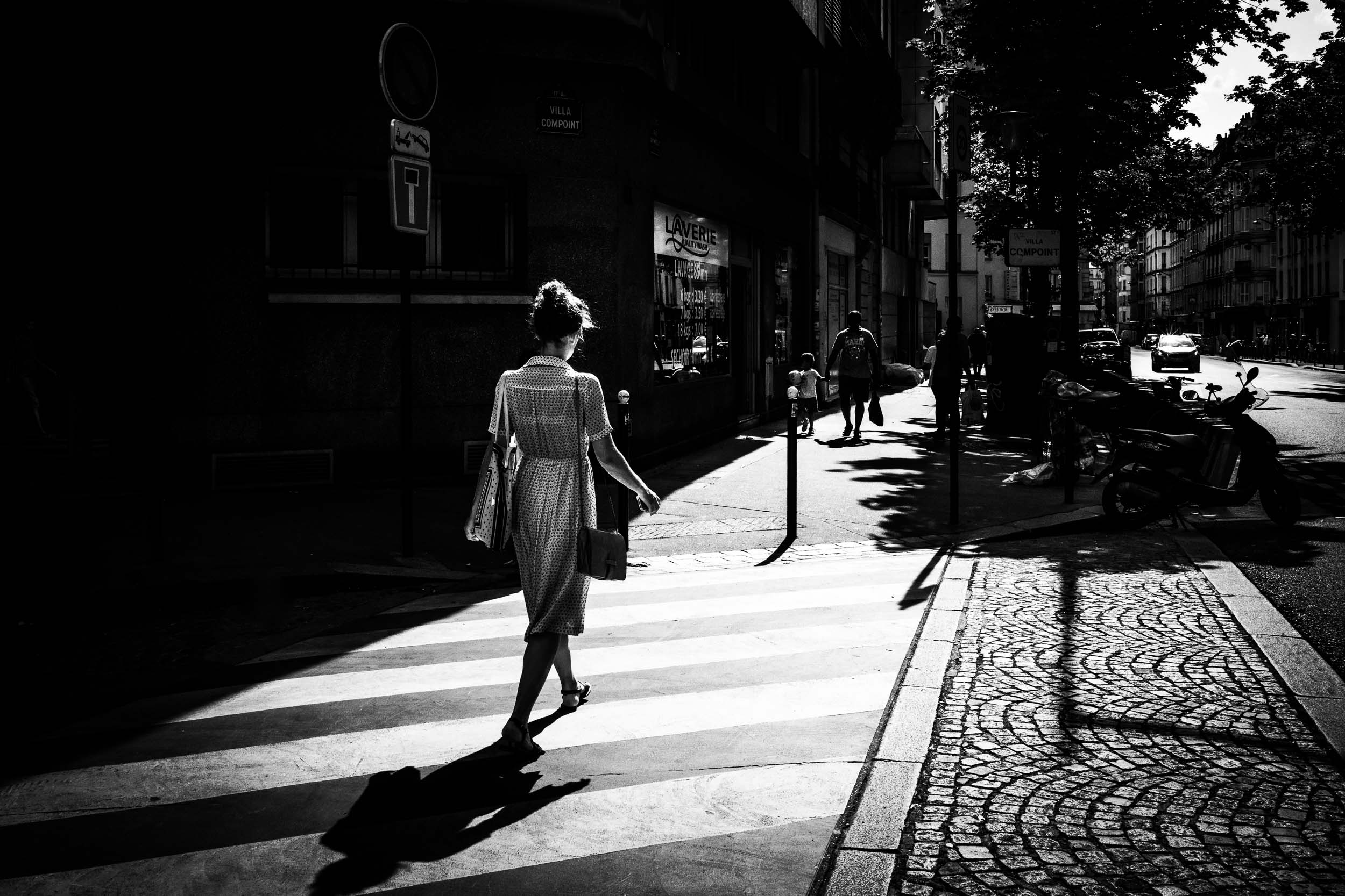 Paris-woman-crossing-street-contrasted-light.jpg