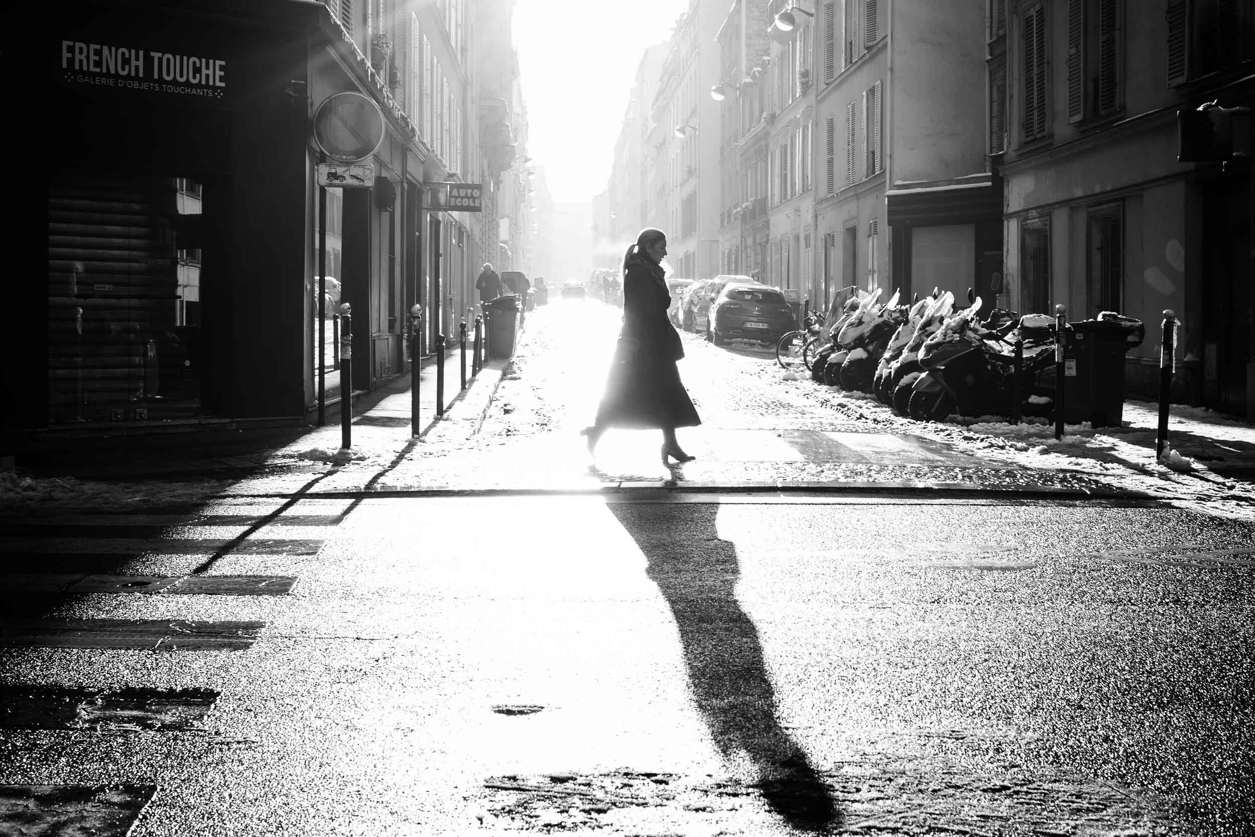 Paris-Woman-Crossing-Street-in-Beautiful-Morning-Light.jpg